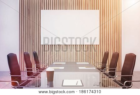 Wooden conference room interior with long table with reflecting surface clipboards lying on it and two rows of black office chairs by its sides. Horizontal poster. 3d rendering mock up toned image
