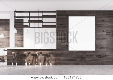 Front view of a bar interior with dark wooden walls a bar counter and a row of stools along it. There is a poster on the wall. 3d rendering mock up