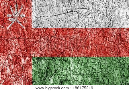 Grudge stone painted Oman flag close up
