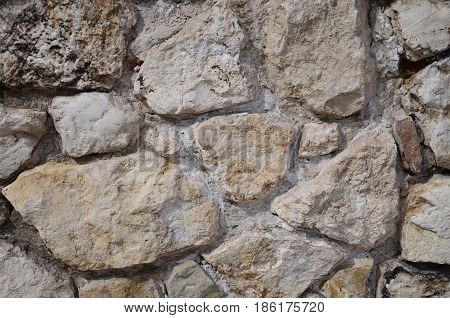 Old, historic wall of white untreated stone