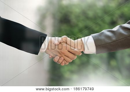 M&a (mergers And Acquisitions) , Businessman Handshake Working At Office M&a