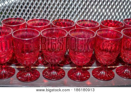 Closeup of emplty red wineglasses standing at dinner party or rout