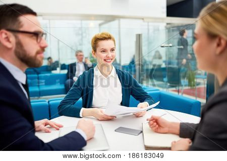 Two employers interviewing young candidate for vacancy