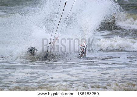 kitesurfer crashing in to a breaking wave