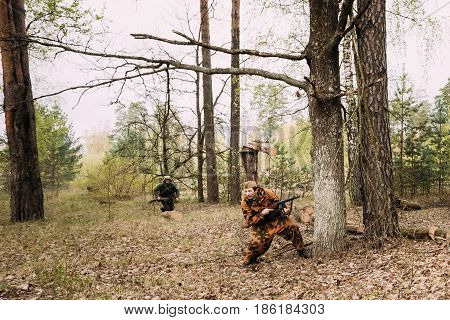 Pribor, Belarus - April 24, 2016: Re-enactor Dressed As Soviet Russian Red Army Infantry Soldier Of World War II In Attack With Submachine Gun In Forest At Spring Season.