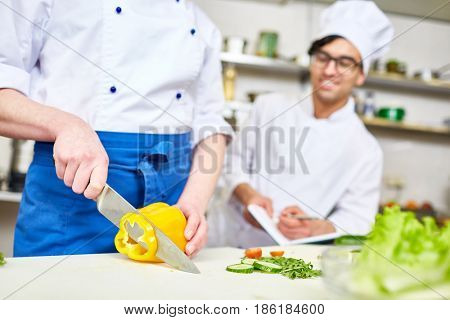 Trainee attending classes of cooking healthy food
