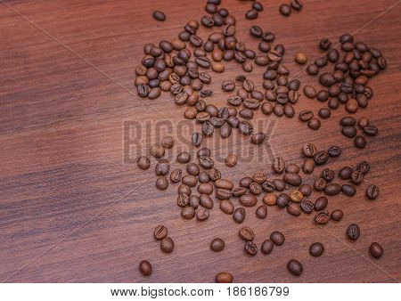 Beautiful coffee beans Fried coffee beans on a chocolate board.