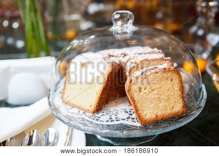 Festive sweet bread with sugar powder, cake with powdered sugar on holiday