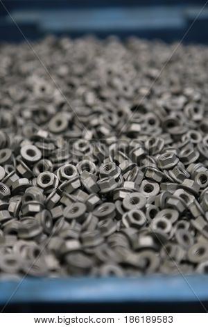 pile of screw nuts in close up