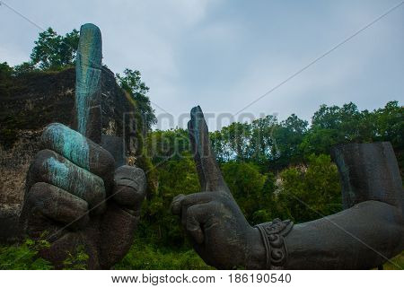 Garuda Wisnu Kencana Cultural Park. Huge Hands Of A Statue Of Vishnu. Bali. Indonesia.