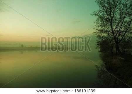 Foggy River Bank Scenery. Low Laying Fog Along the River. Lesser Poland.