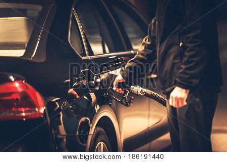 Men Refueling His Diesel Engine Car. Bio Diesel Fuel Concept Photo.