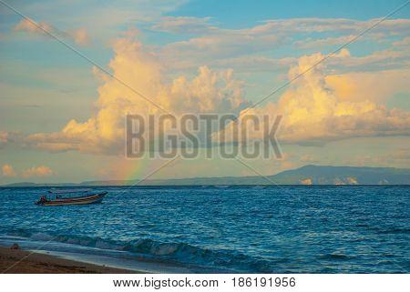 Sea, Clouds, Boat, Rainbow. Nusa Dua Bali. Geger Beach. Indonesia.