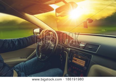 Sunset Scenery Car Drive. Wide Angle Car Interior View and the Spring Sunset on the Outside. Car Travel Concept.