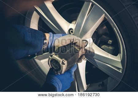 Winter Tires Replacement and Rotation in the Car Service. Vehicle Seasonal Maintenance.