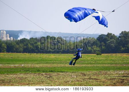 The skydiver landing on grass airfield. Ukraine