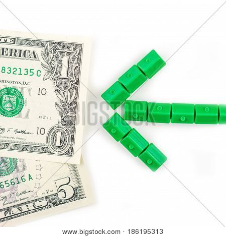 Arrow Made Of Miniatur Green Houses Is Directed To The Dollar Banknote