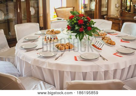 Wedding decor. restaurant interior. Festive white decor, table layout concept. expectation of guests.