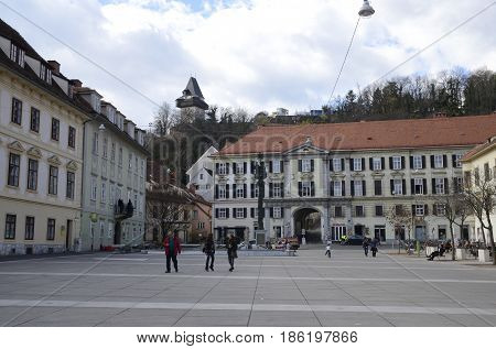 GRAZ, AUSTRIA - MARCH 19, 2017: The tower of the clock seen from the Carmelite Square in Graz the capital of federal state of Styria Austria.