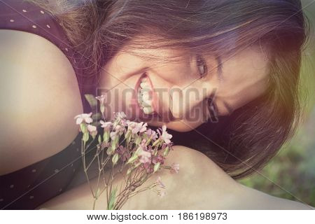 smiling girl portrait closeup look at camera outdoor in field summer day