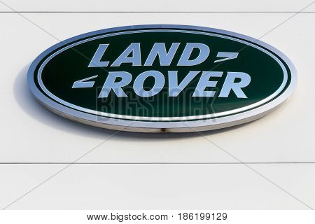 Aarhus, Denmark - January 17, 2016: Land Rover logo on a wall. Land Rover is a car brand that specialises in four-wheel-drive vehicles, owned by British multinational car manufacturer Jaguar Land Rover