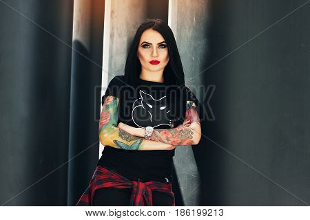 Gothic Beauty. Portrait Of Attractive Tattoed Hipster Girl Posing To Camera While Standing Against U