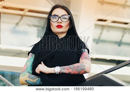 Gothic Beauty. Portrait Of Attractive Tattoed Hipster Girl Keeping Arms Crossed While Standing Again