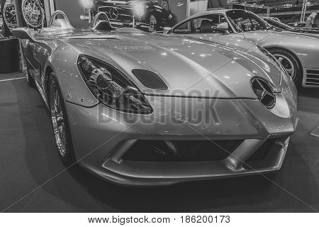 STUTTGART GERMANY - MARCH 02 2017: Grand tourer car Mercedes-Benz SLR McLaren Stirling Moss (limited edition 75 vehicles) 2009. Stylization. Black and white. Europe's greatest classic car exhibition