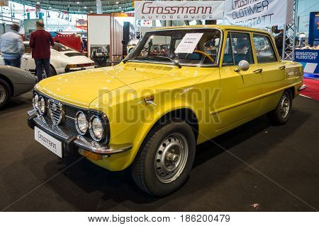 STUTTGART GERMANY - MARCH 02 2017: Large family car Alfa Romeo Giulia Nuova Super 1975. Europe's greatest classic car exhibition