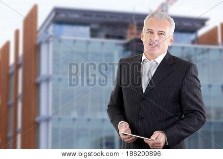 adult Handsome businessman portrait outside office building