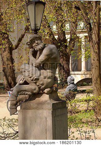 Centaur from Lazienki Park. Warsaw, Poland - April 08, 2017 Centaur sculpture at the lantern in Lazienki Park in Warsaw.