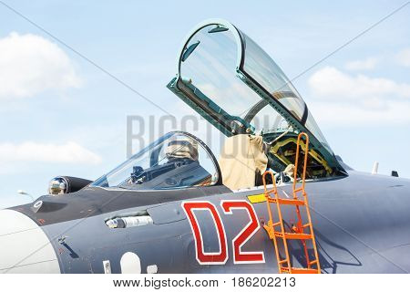 nose and cockpit of jet military plane, a bomber on a background of blue sky
