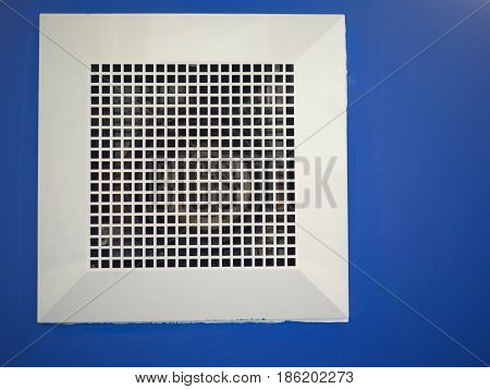 air purifier filter on blue ceiling background