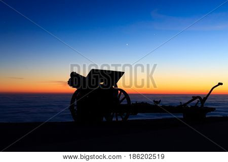 Cannon Silhouette At Twilight