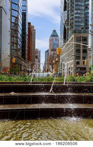 NEW YORK CITY USA - 04 2017 : The water in the fountain and splash water fountain on the background of New York