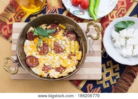 Fried eggs with pepperoni with fresh tomato and peppers and cheese