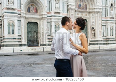 Young Couple Honeymoon walking in Florence Italy.