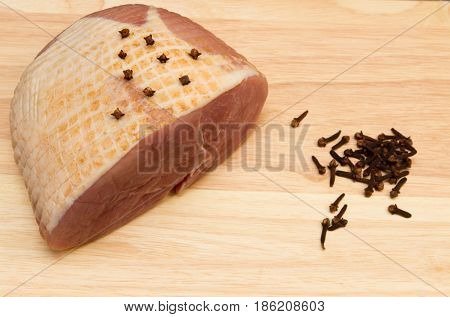 Gammon joint A raw gammon joint studded with cloves