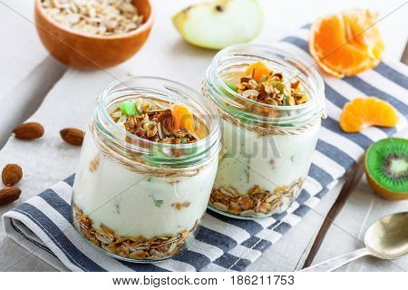 Healthy meal made of granola yogurt and fruits. Delicious food for breakfast. Traditional American snack.