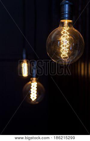 Steampunk lamps hanging in the dark studio