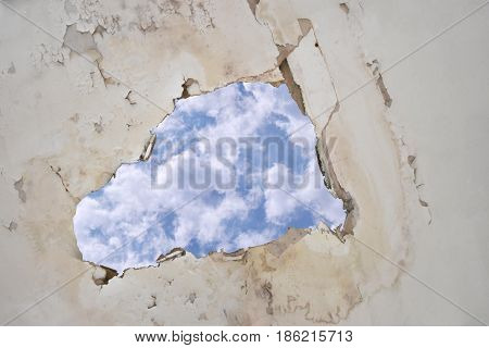 Water leak on the ceiling causing damage tiles sky with clipping path