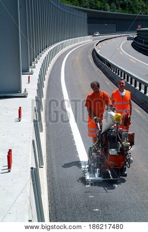 Machine Eject And Worker On Road And Traffic Sign Painting