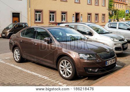 RASSTAT GERMANY - APR 13 2017: Front view of maroon topaze new Skoda Octavia estate car parked in dedicated parking place in Rasstat Germany Baden Wurtemberg