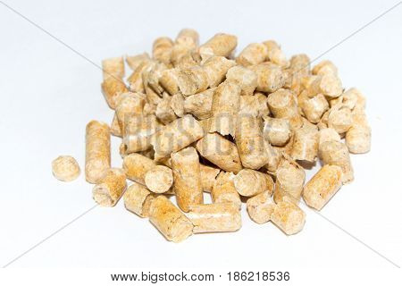 Wood pellets isolated on white background .