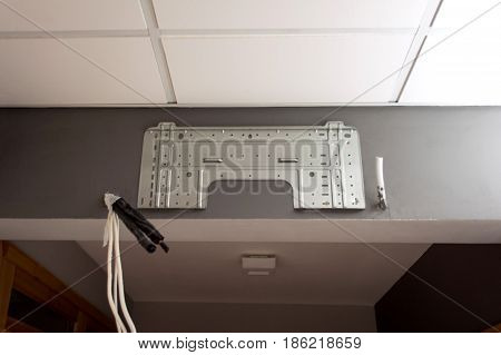 Air conditioner installation servicing indoor with connection cables tubes inside office and home on a gray wall ac service for best filter efficiency and pure air ventilation