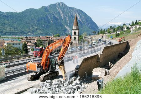 Hydraulic Digger Breaking Up A Wall