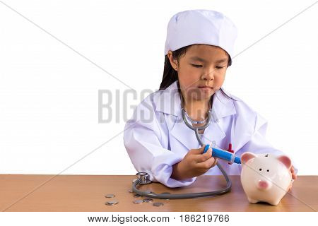 Asian girl playing as a doctor care Piggy Bank isolated background with clipping path.