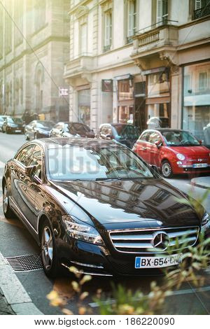 STRASBOURG FRANCE - APR 3 2017: Luxury Mercedes-Benz CLS 350d Klass detail on parked on a European city street at sunset