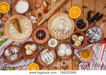 A lot of food on the wooden table. Georgian cuisine. Top view. Flat lay . ice cream and Georgian dishes.