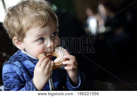 Child Eating Curd Ring Cake